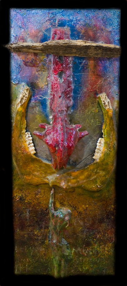 "Drew Wood, The Road Less Traveled, 2006, color-shifting enamel, acrylic, encaustic, found driftwood, reflective tape, bovine jawbone and teeth, plaster plevis, skull, and hand, United Kingdom coin, copper, pumice, garnet, phorsphorus, and synthetic resin on canvas, 14.5""x42""x3"""